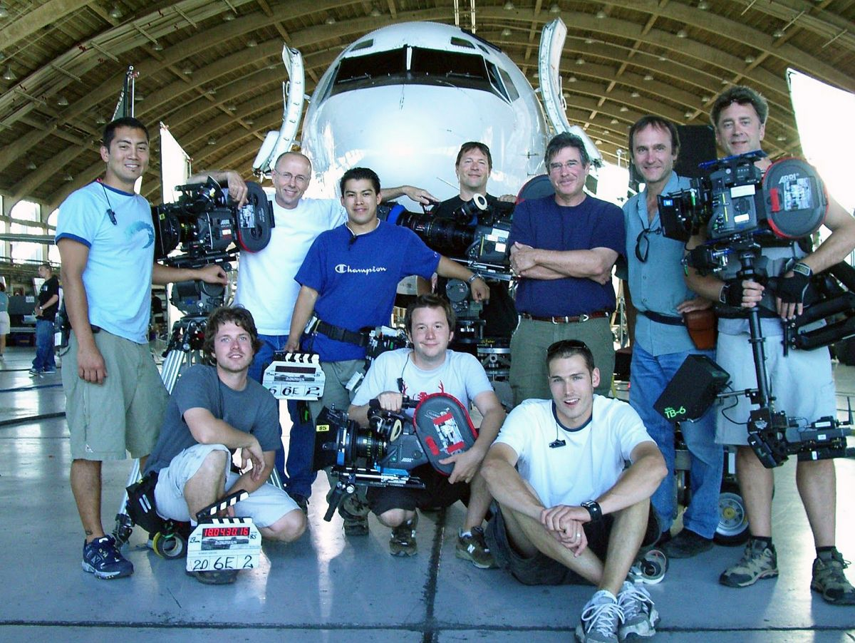 The Supernatural team from Season 1 in 2005 included (from left, standing) 1st AC Dean Webber, A-camera operator Jim Wallace, 2nd AC Jose Manzano, dolly grip Dave Riopel, executive producer/director Robert Singer, Ladouceur, 2nd camera/Steadicam operator Tim Monayan, (from left, crouching) camera trainee Kyle Brown, 1st AC Matthew Tichenor and 2nd AC Ian Levine.