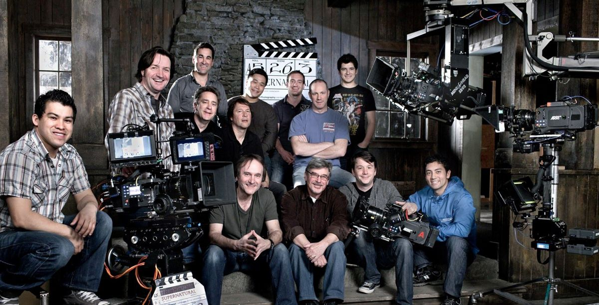 The Supernatural team from Season 6 in 2010-'11 included (from left, front row) 2nd AC Jose Manzano, Ladouceur, executive producer/director Robert Singer, 1st AC Matthew Tichenor, 1st AC Dean Webber, (second row) A-camera operator Brad Creasser, 2nd camera/Steadicam operator Tim Monayan, dolly grip Dave Riopel, 2nd AC Peter Hunter, (third row) 2nd camera/Steadicam operator Brian Rose, DIT Ray Wong, dolly grip Steve Gilmore and 2nd AC Rodrigo Carcamo.