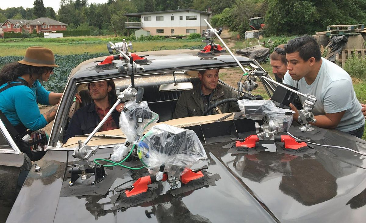 """Padalecki (also below) gets a final touch up as 2nd AC Jose Manzano and dolly grip Dave Riopel are among the crew rigging the Impala for the Season 11 episode """"Baby."""""""