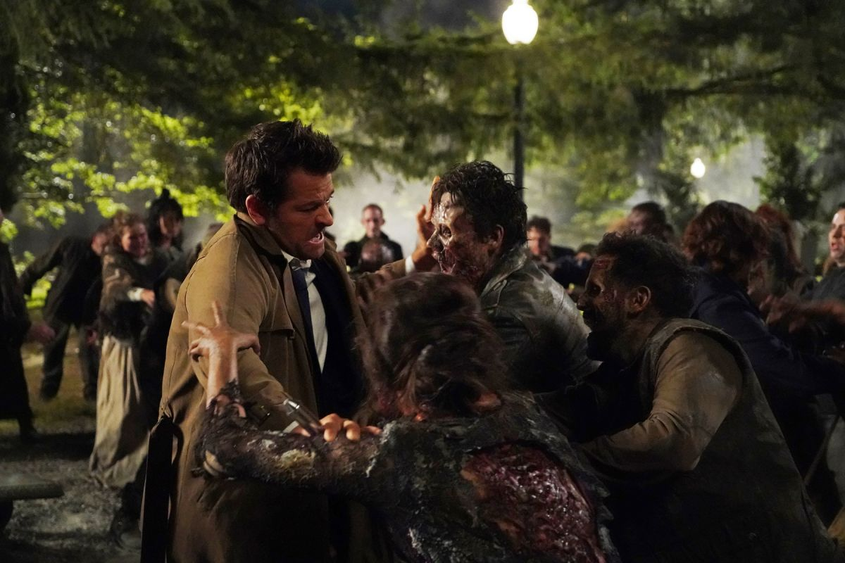 "Castiel (Misha Collins) and the Winchesters are surrounded by the undead in the Season 15 episode ""Raising Hell."""