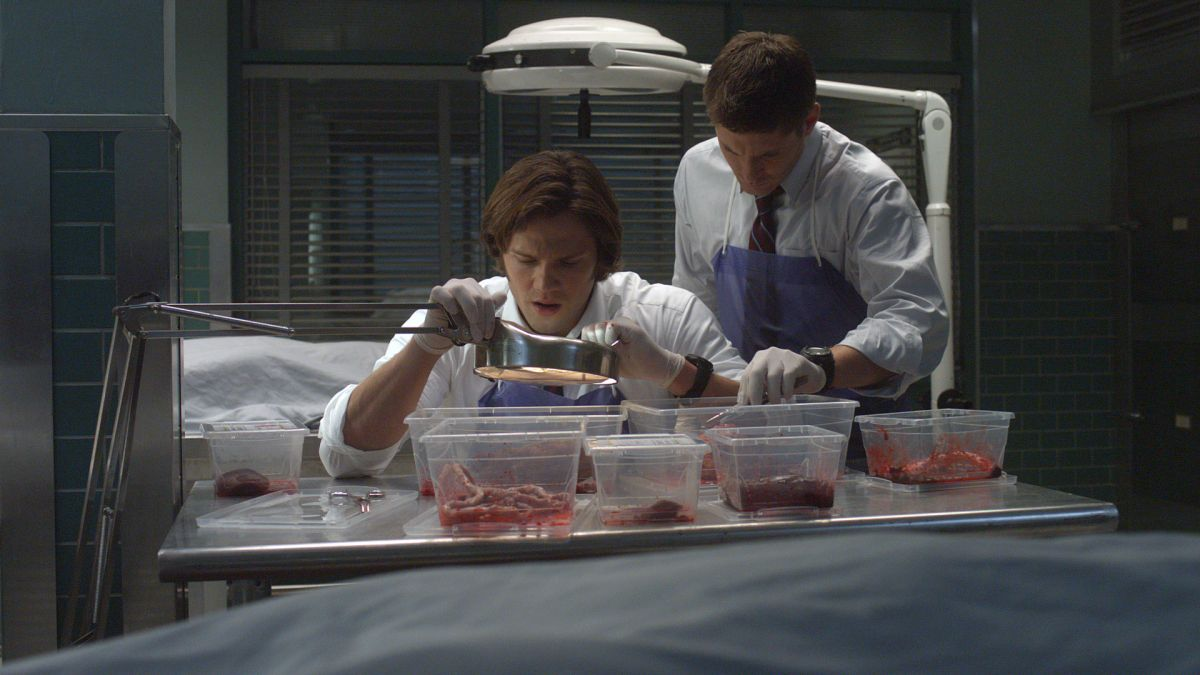 "In one of the show's many ""morgue"" scenes, Sam and Dean examine the bloody remains of an unlucky victim."