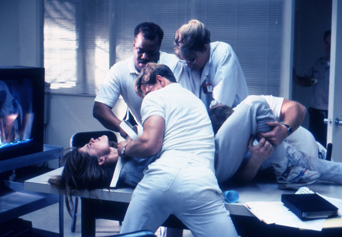 Sarah Conner (Linda Hamilton) resists orderlies the Pescadero State Hospital.
