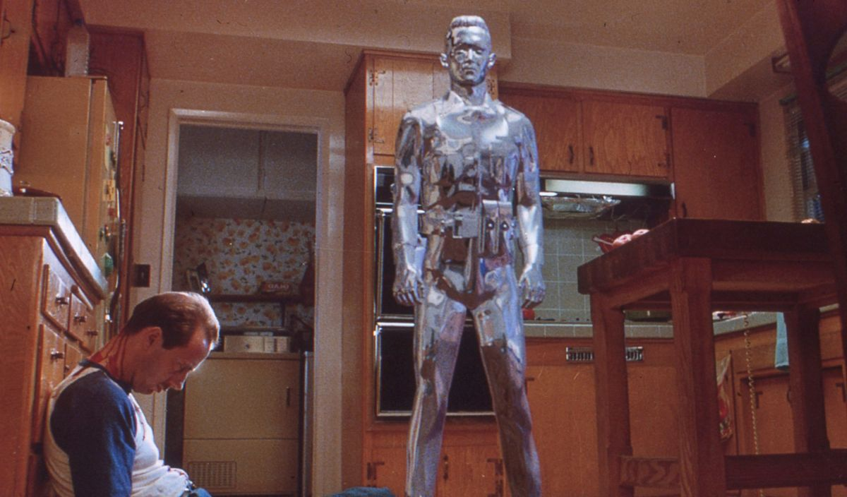 In this multi-part metamorphosis the T-1000 changes from the likeness of John's foster mother, Janelle — whose husband he has just murdered — back into the liquid form.