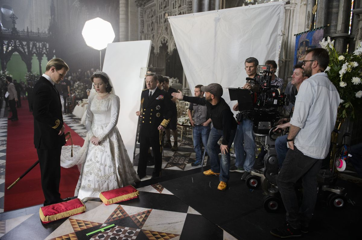 "Goldman directs the positioning of a bounce card for the show's first episode, ""Wolferton Splash,"" in which Elizabeth II (Foy) weds Prince Philip (Matt Smith)."