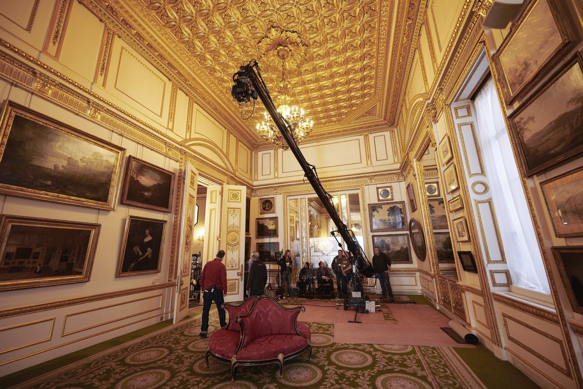 A crane is deployed to shoot an interior scene.