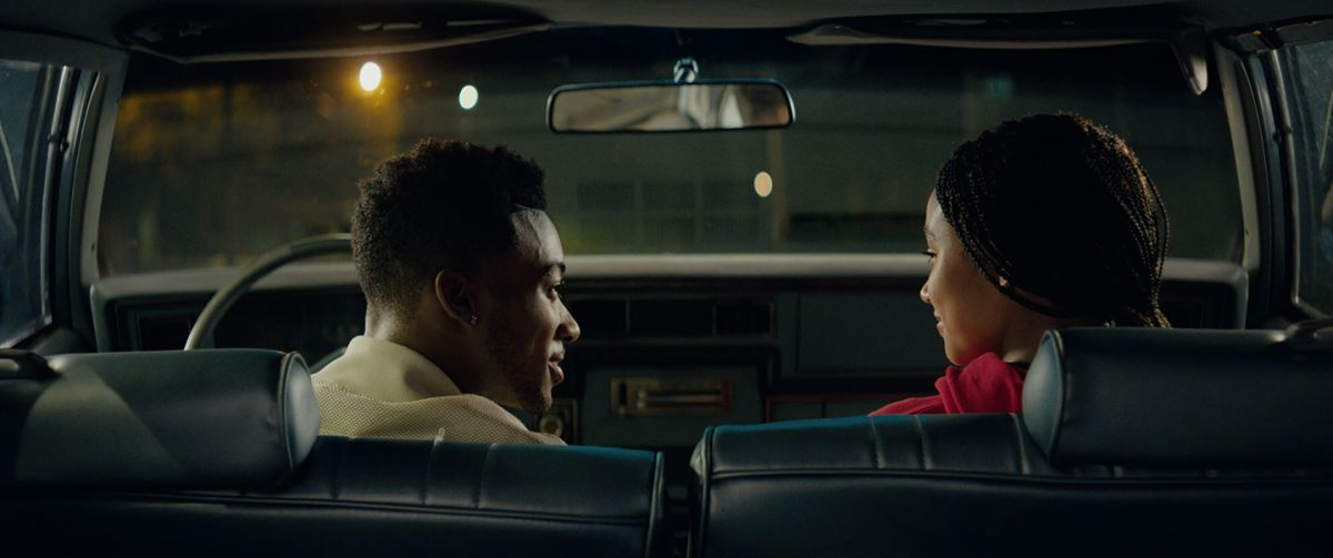 Kahlil (Algee Smith) and Starr (Amandla Stenberg) share a romantic moment in a car shortly before Kahlil is killed.