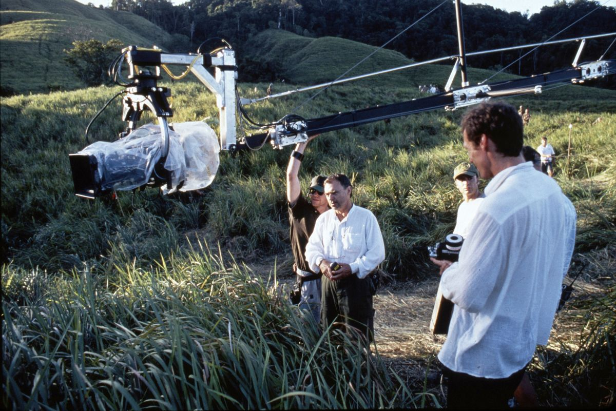 "Toll (center, in white shirt) and his crew maneuver the Akela crane arm and Libra 3 remote head into position. The cinematographer used the crane to create smooth, compelling ""dolly"" shots over the