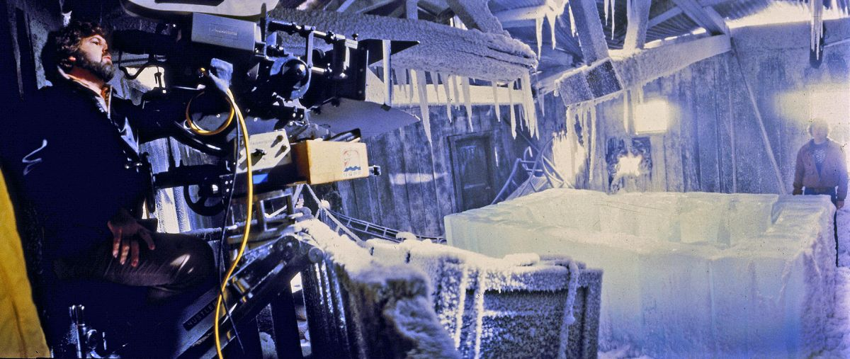 On stage at Universal Studios, Dean Cundey sets a shot with the help of a stand-in during the production of The Thing. (Photo from the collections of the Margaret Herrick Library.)