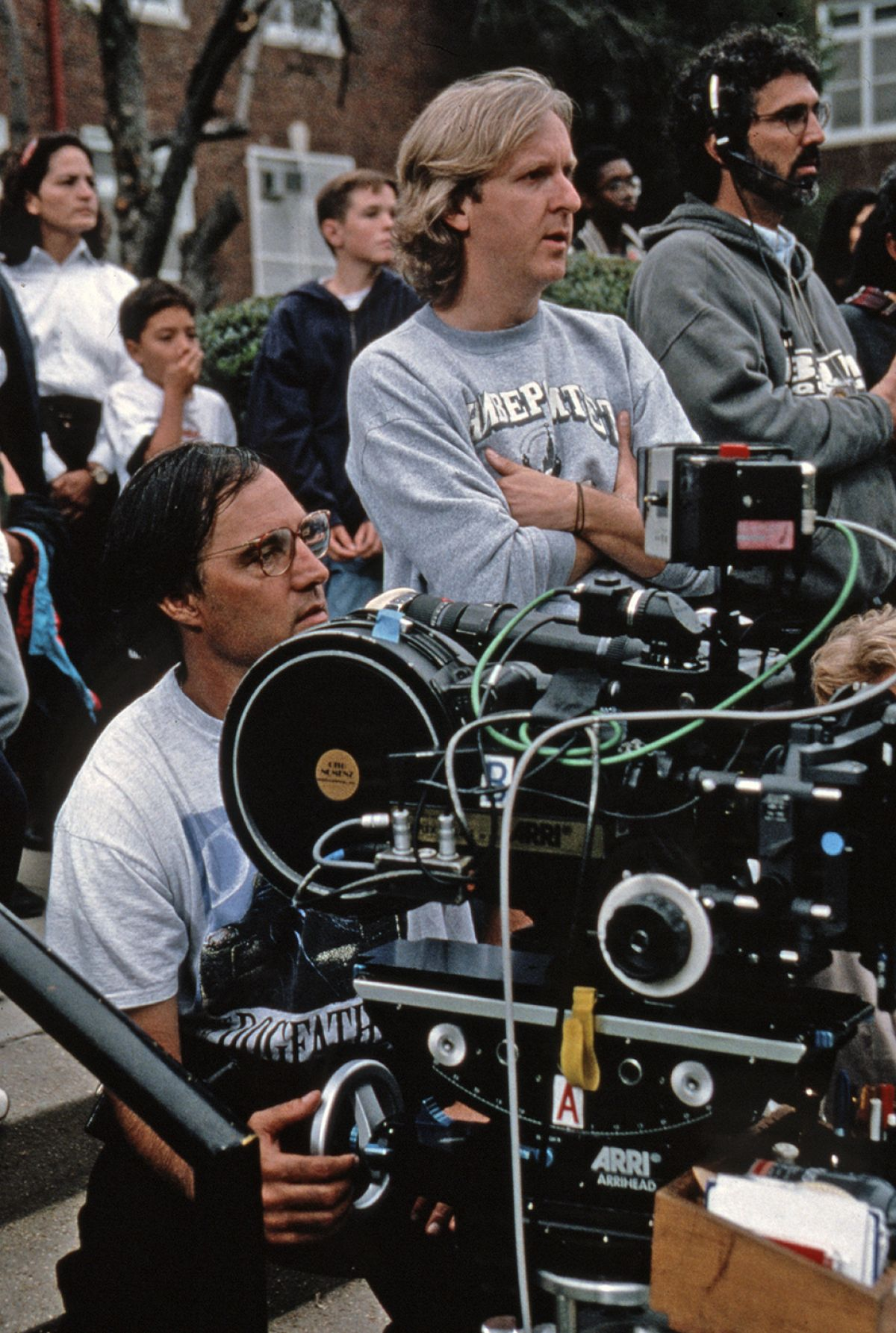Cinematographer Russell Carpenter (left) and director James Cameron (center) work out a shot on location.