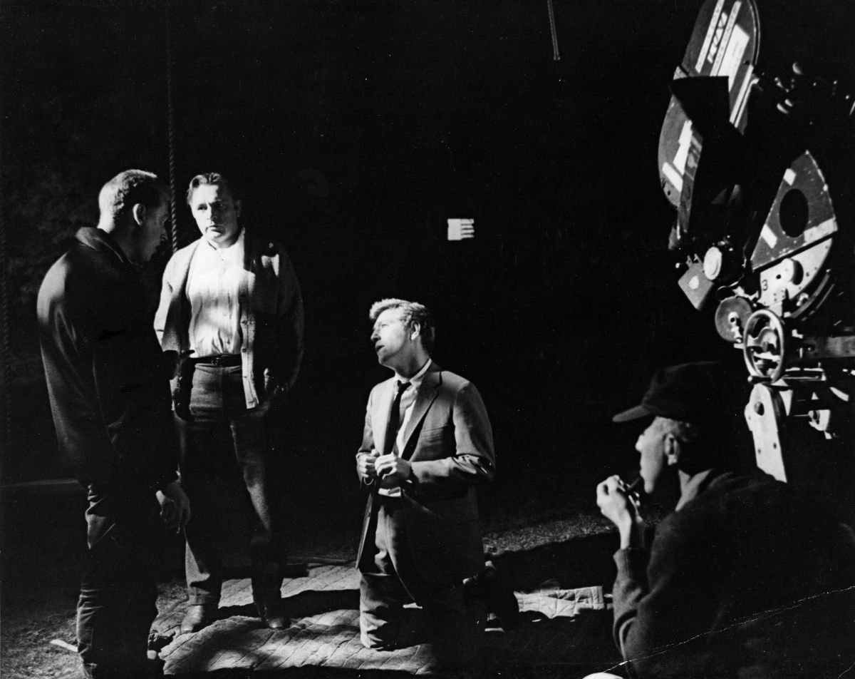 Nichols gives instructions to Richard Burton and George Segal prior to the shooting of night location sequence during extensive filming on the campus of Smith College in Northampton, Mass.