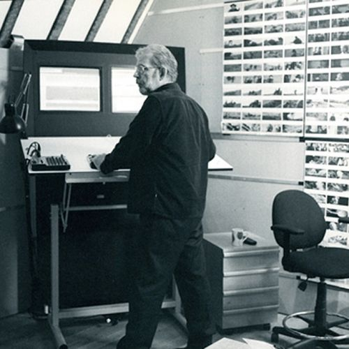 Walter Murch standing as he edits
