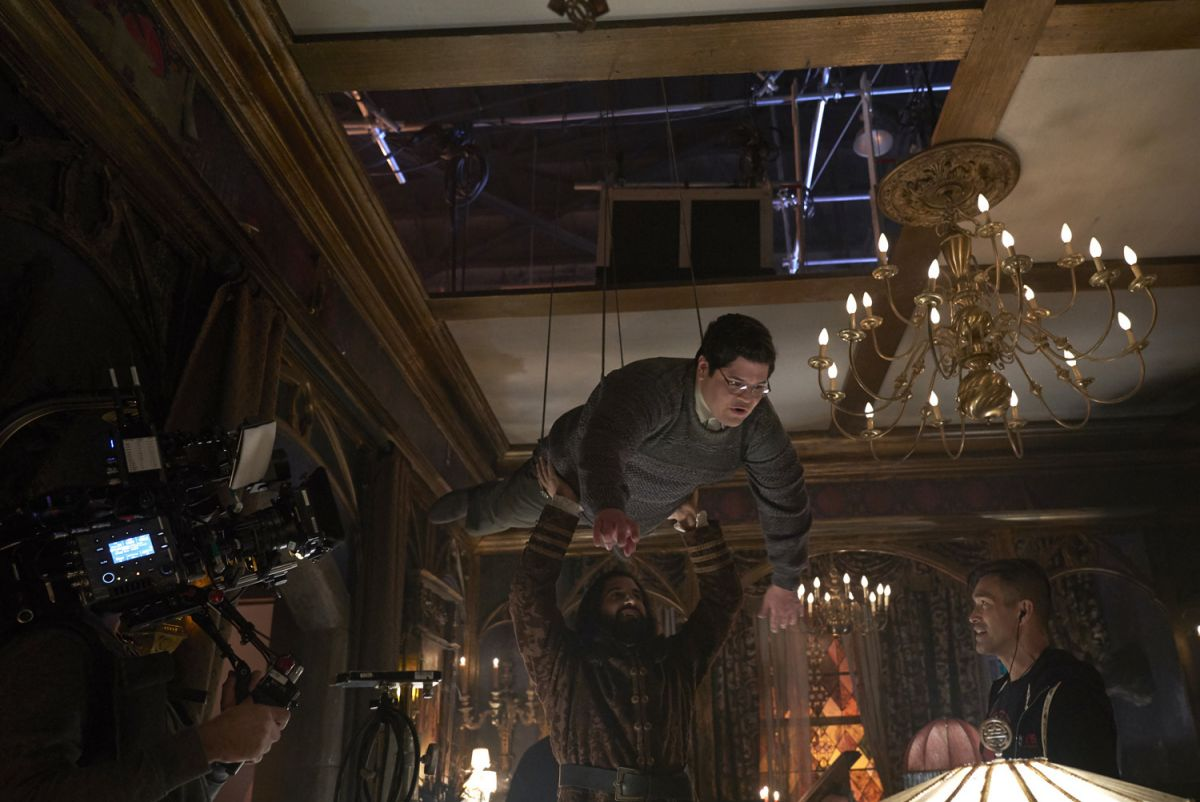 "A handheld Sony Venice captures a shot of Guillén suspended on wires. ""We needed ceilings throughout our sets so we wouldn't have any 'shoot-off' issues that might restrict the actors' movements during a scene, but all of the ceilings had to be removable for wirework,"" Stipsen says. The ceiling pieces, he adds, ""were stretched unbleached muslin — which the painters had aged — over a wooden frame."""