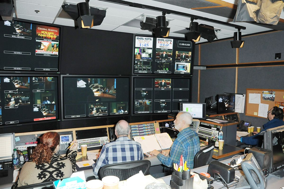From left: Associate director Teresa Cicala, director William Ludel, technical director Chuck Abate and lighting director Bob Bessoir work at a fast pace inside the production control booth.