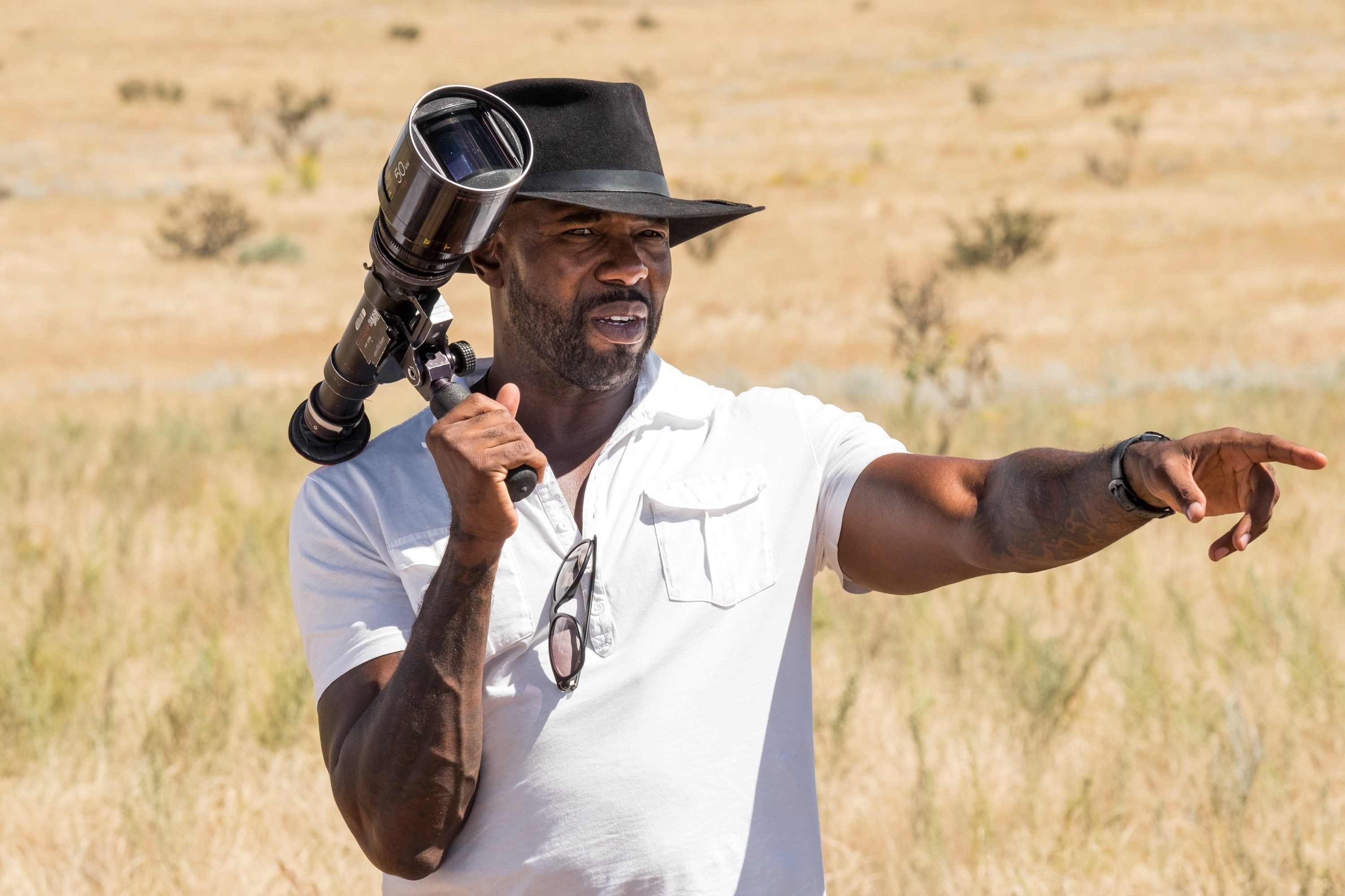 Director Antoine Fuqua examines shot options on the set of The Magnificent Seven.