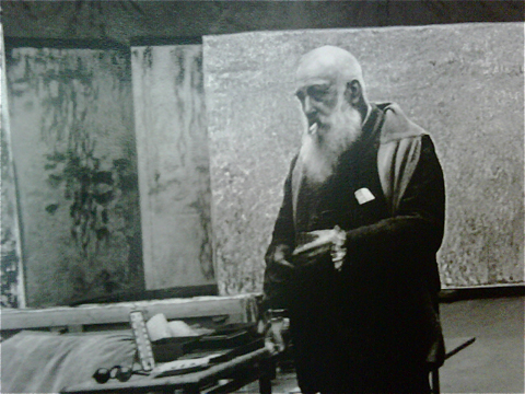 Monet in 1923, in his studio.